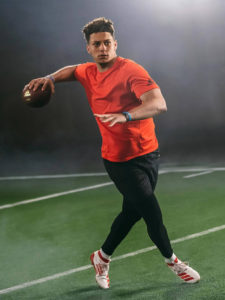 1UP Sports Marketing client Patrick Mahomes about the throw the football during a video shoot
