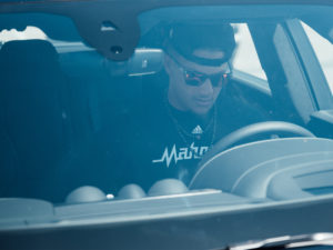 1UP Sports Marketing client Patrick Mahomes sitting inside his Bentley