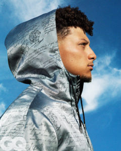 Side shot of 1UP Sports Marketing client Patrick Mahomes wearing a silver hoodie for a GQ photoshoot