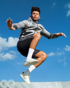 1UP Sports Marketing client Patrick Mahomes springs in the air wearing shorts and adidas sneakers for a GQ photoshoot