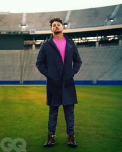 1UP Sports Marketing client Patrick Mahomes standing in the middle of a football field for a GQ photo shoot