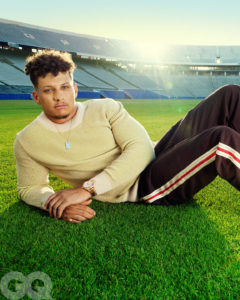 1UP Sports Marketing client Patrick Mahomes lies on his side while wearing a sweater and sweatpants for a GQ photoshoot