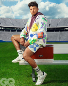1UP Sports Marketing client Patrick Mahomes sits on a cooler for a GQ photoshoot