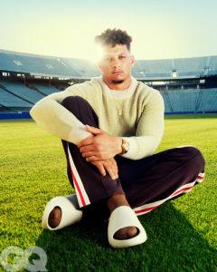 1UP Sports Marketing client Patrick Mahomes wears a sweater and sweatpants for a GQ photoshoot