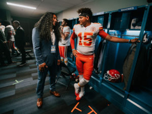 1UP Sports Marketing client Patrick Mahomes chats with Troy Polamalu in a locker room