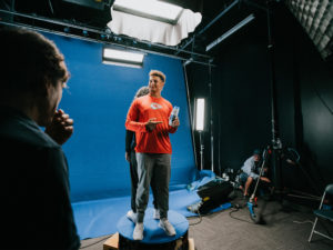 1UP Sports Marketing client Patrick Mahomes smiling and pointing at a shampoo bottle during a Head & Shoulders commercial