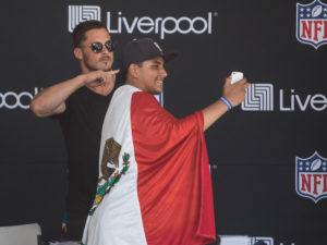 1UP Sports Marketing clients Danny Amendola posing for a selfie with a Mexican fan wearing the Mexican flag