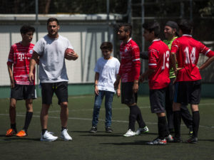 1UP Sports Marketing clients Danny Amendola in Mexico with young athletes