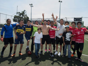 1UP Sports Marketing clients Danny Amendola and Julian Edelman in Mexico posing for a photo with soccer players