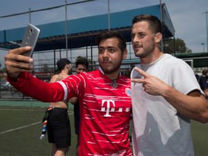 1UP Sports Marketing clients Danny Amendola posing for a selfie with a Mexican fan