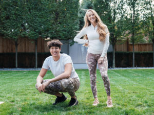 1UP Sports Marketing clients Brittany Lynne Matthews and [brother of Patrick Mahomes] Jackson Mahomes standing in a grassy lawn