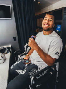 1UP Sports Marketing client Bradley Chubb with a Snickers bar in his mouth - vertical
