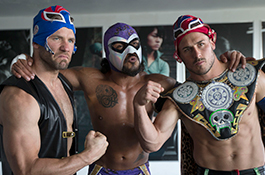 1UP Sports Marketing clients Danny Amendola and Julian Edelman pose with a Mexican wrestler in full wrestling outfits