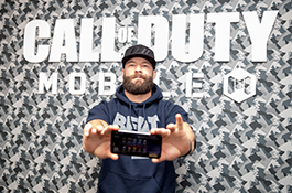 1UP Sports Marketing client Julian Edelman holding a mobile phone at the Call Of Duty: Mobile launch event