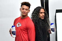 1UP Sports Marketing client Patrick Mahomes poses with Troy Polamalu for a Head and Shoulders commercial