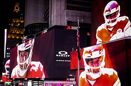 1UP Sports Marketing client Patrick Mahomes on the big video screens at Times Square as part of an Oakley ad campaign