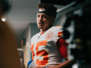 1UP Sports Marketing client Patrick Mahomes standing in the locker room during the filming of a Head & Shoulders commercials